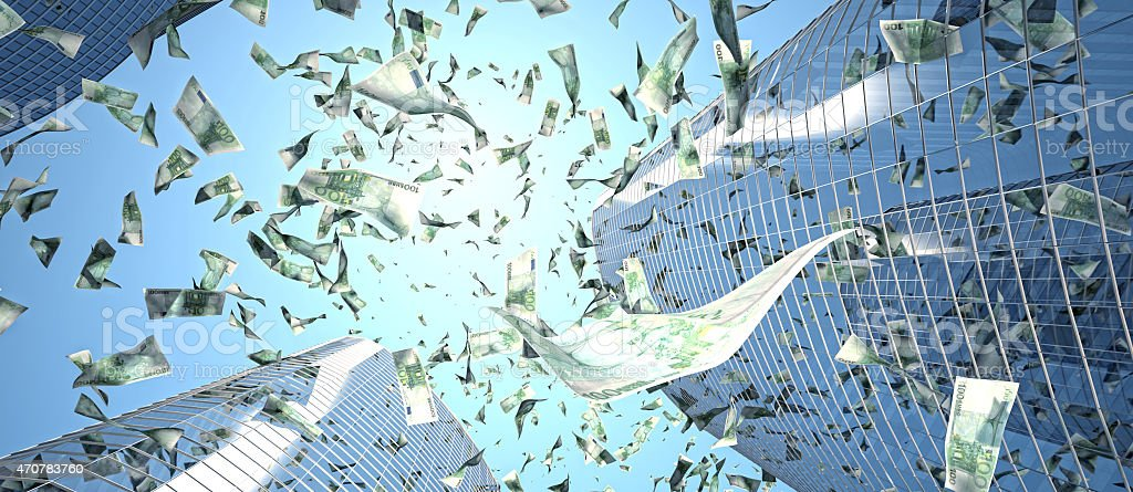 Money being dropped out tall glass buildings stock photo