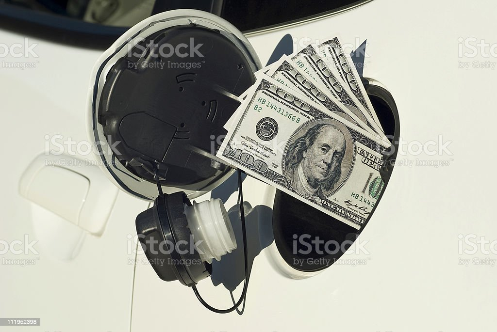 Money Being Sucked Into Gas Tank royalty-free stock photo