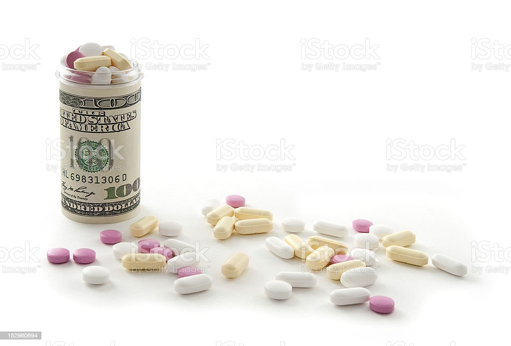 Money bottle full of pills stock photo