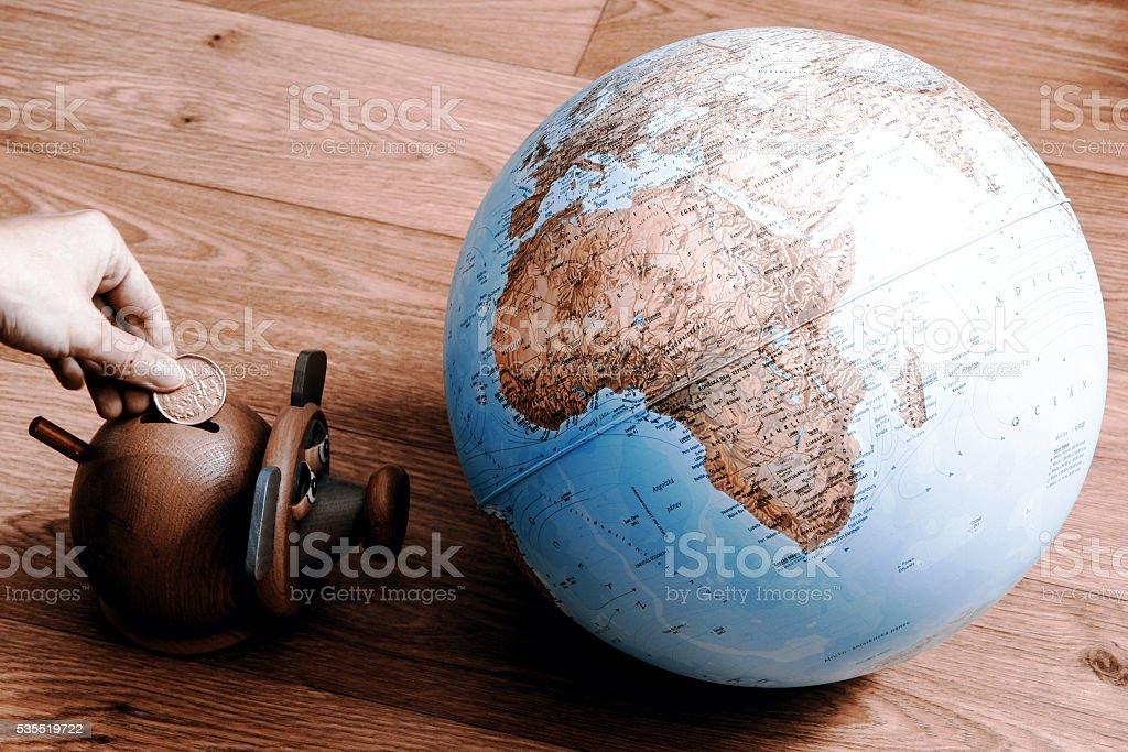 Money box with globe of world stock photo