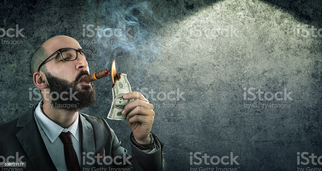 money burning - businessman arrogant stock photo