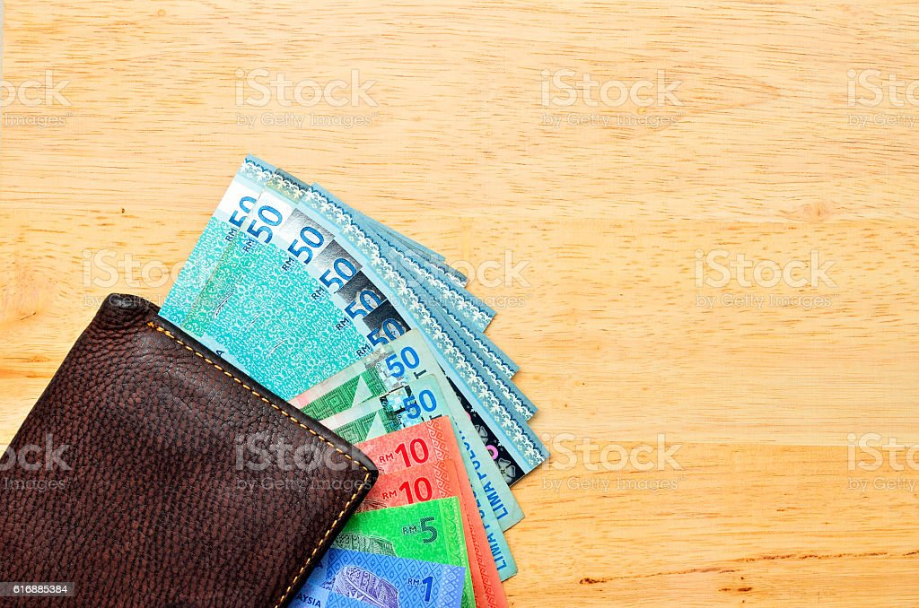 Money cash wallet on wooden table with copy space stock photo