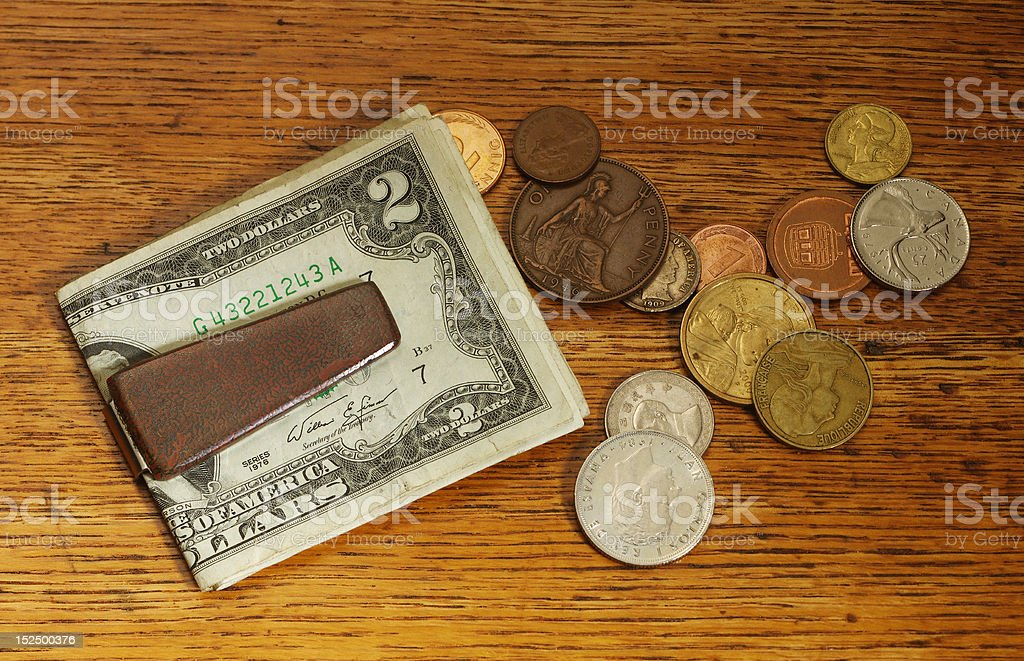 Money clip and coins stock photo