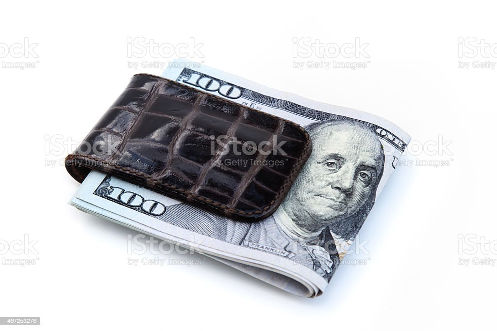 Money clip with Ben Franklin USA currency 100 dollar bills stock photo