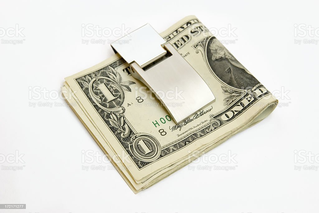 Money clip with dollars stock photo