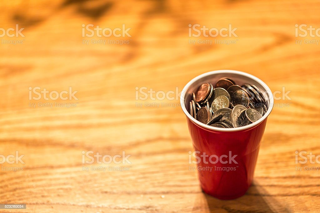 US Money Coins Piled in Plastic Cup stock photo