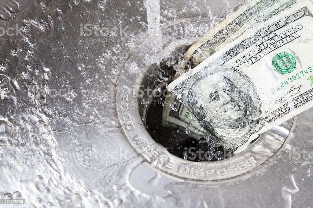 Money Down Drain stock photo