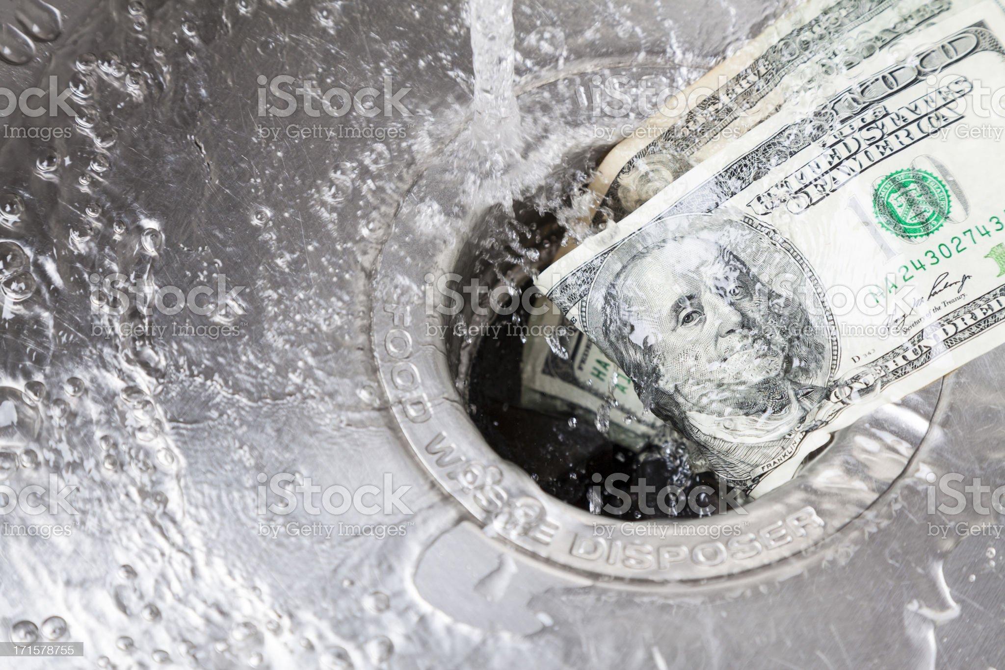 Money Down Drain royalty-free stock photo