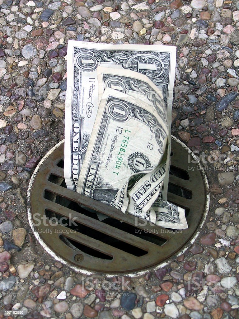 Money Down the Drain 4 royalty-free stock photo