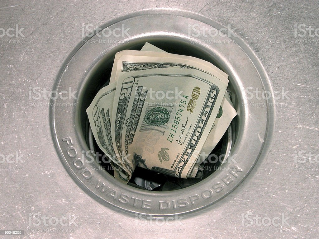 Money:  Down the Drain Dry royalty-free stock photo
