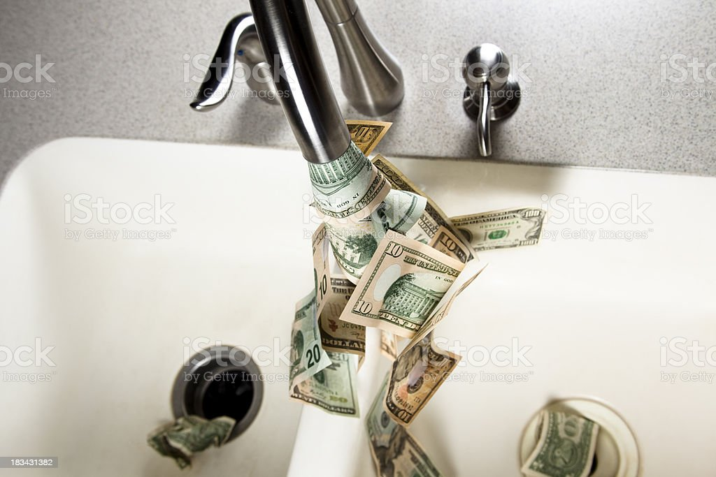 Money down the drain royalty-free stock photo