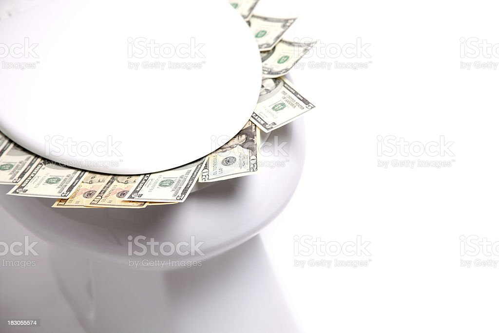 Money down the toilet stock photo