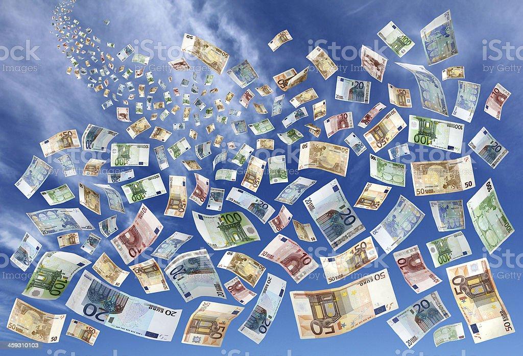 Money falling from sky stock photo