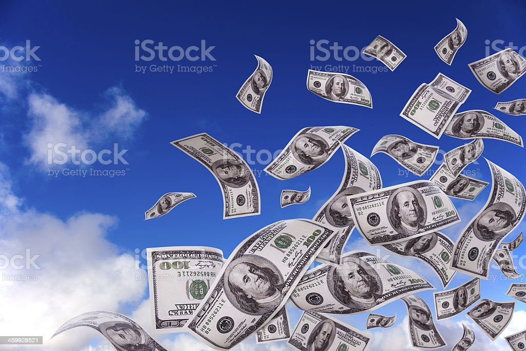 money falling from the sky stock photo