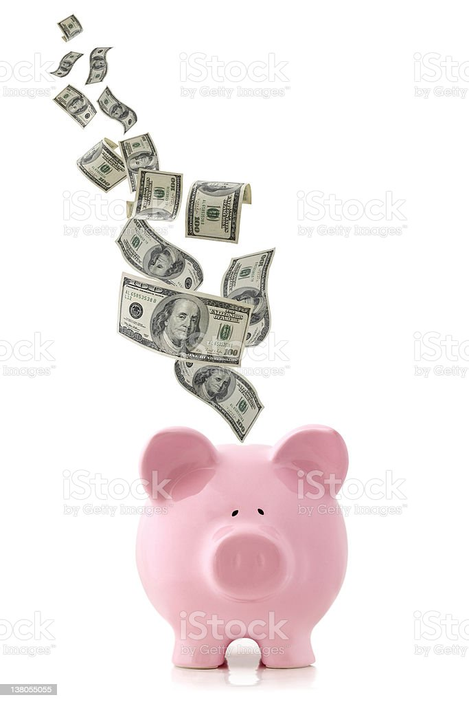 Money Falling into Piggy Bank stock photo