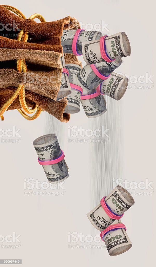 Money falling out of bag. stock photo