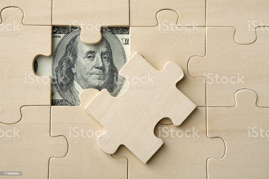 Money: Financial Puzzle royalty-free stock photo