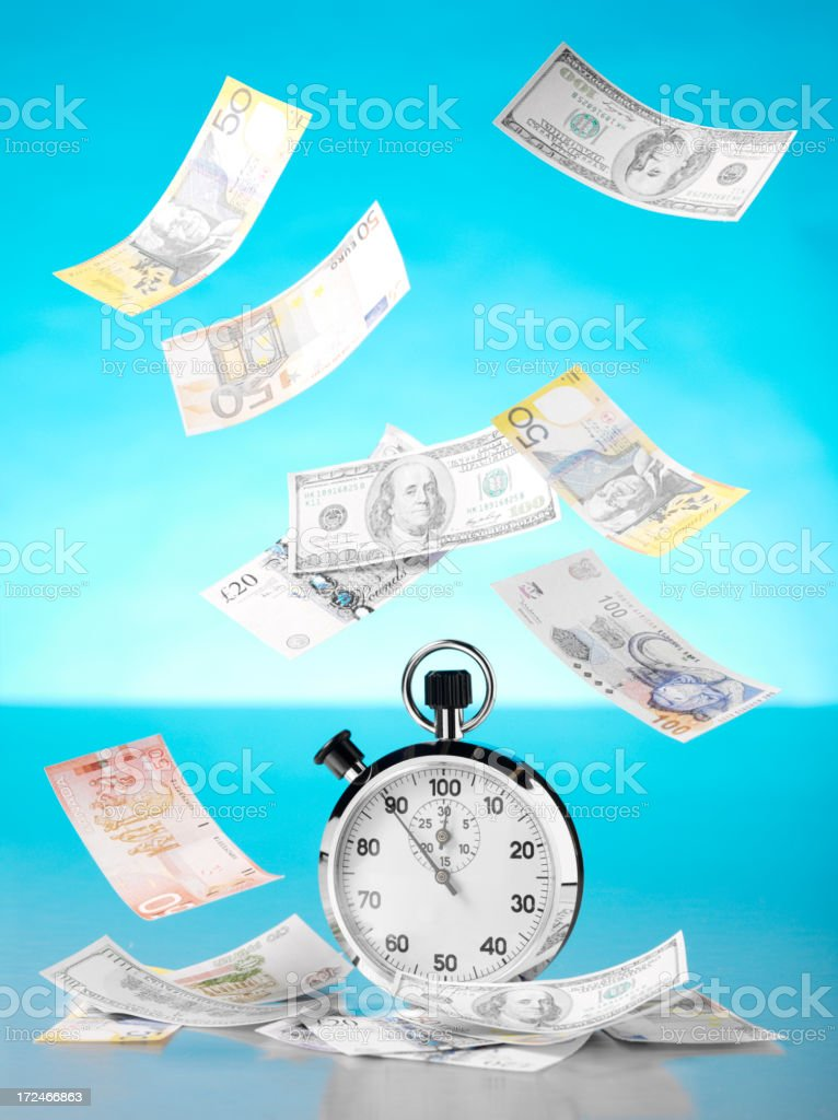 Money Floating Around a Stopwatch royalty-free stock photo