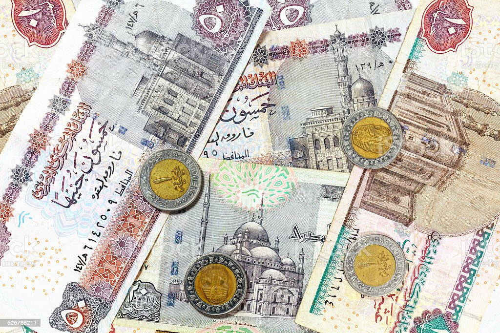 Money from Egypt, pound banknotes and coins. stock photo
