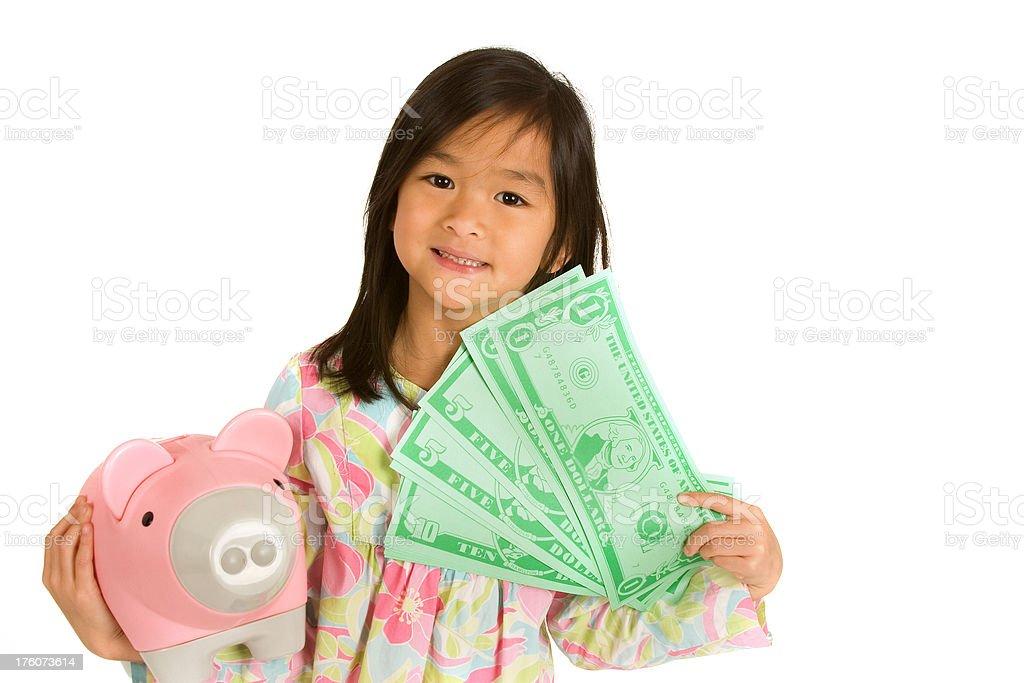 Money girl with piggybank royalty-free stock photo