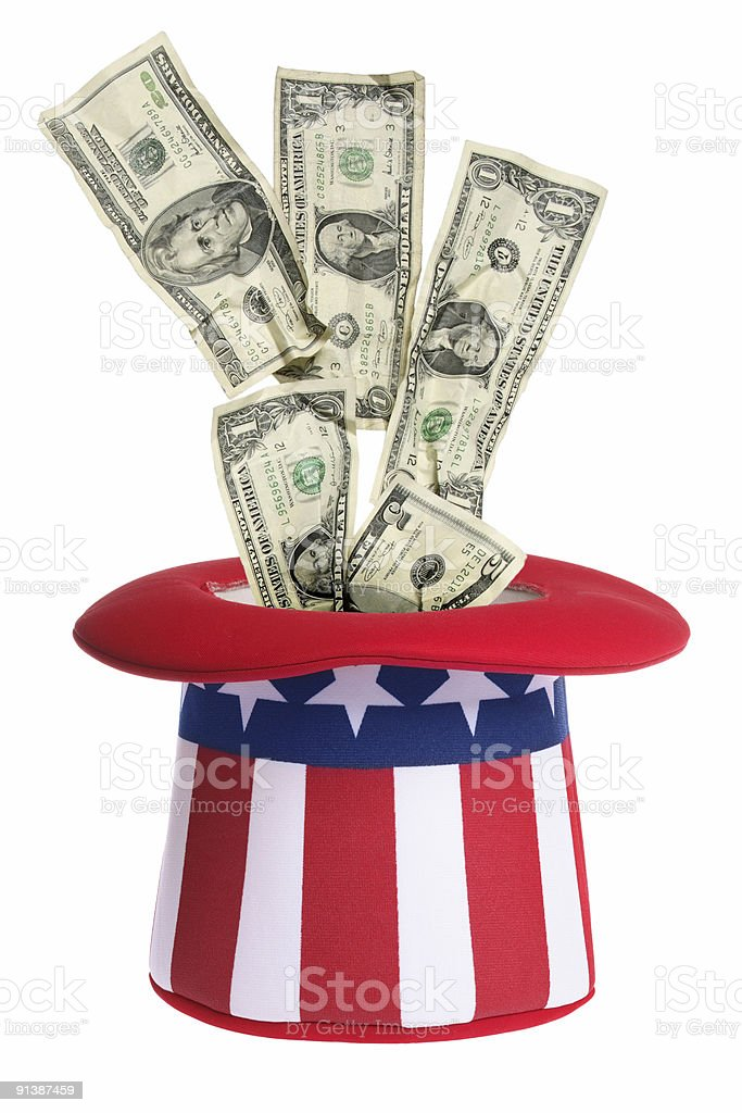 Money going into an Uncle Sam hat stock photo