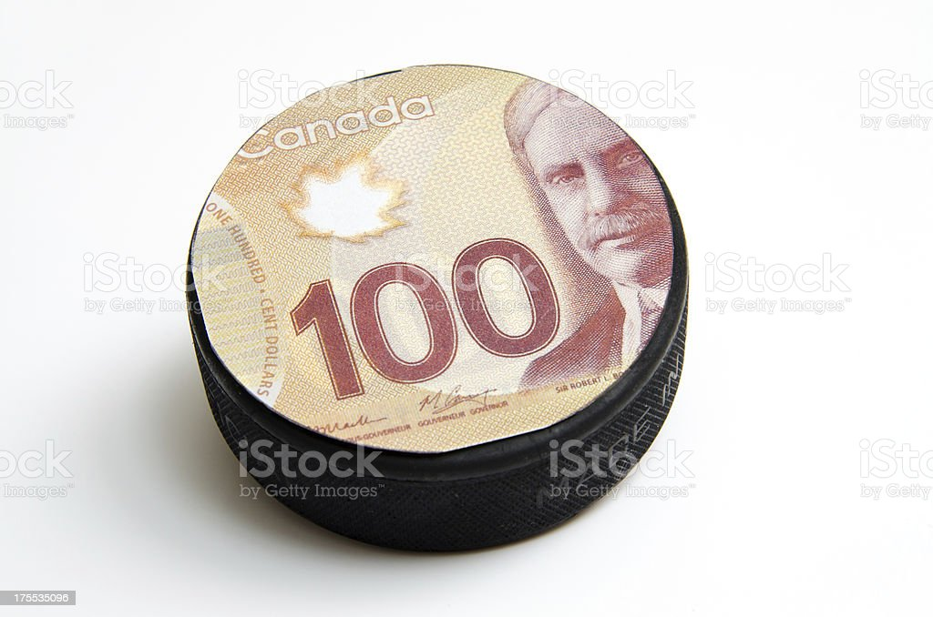 Money Greedy Hockey Puck royalty-free stock photo