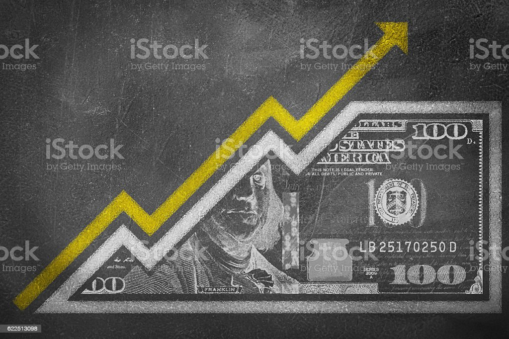 Money Growth Graph on a chalk board stock photo