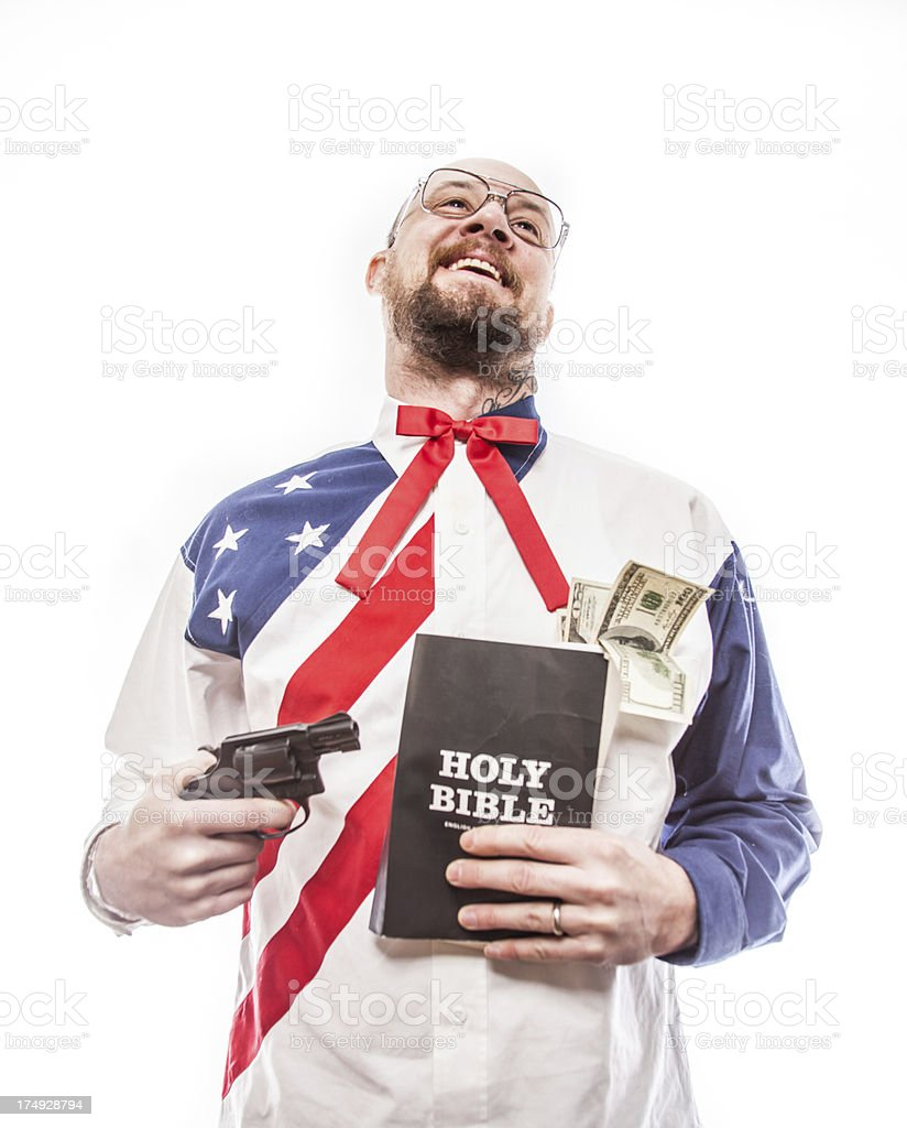 Money Guns and the Holy Bible royalty-free stock photo