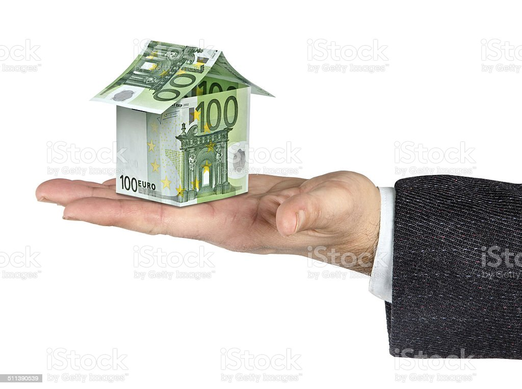 Money home and hand isolated on white background stock photo
