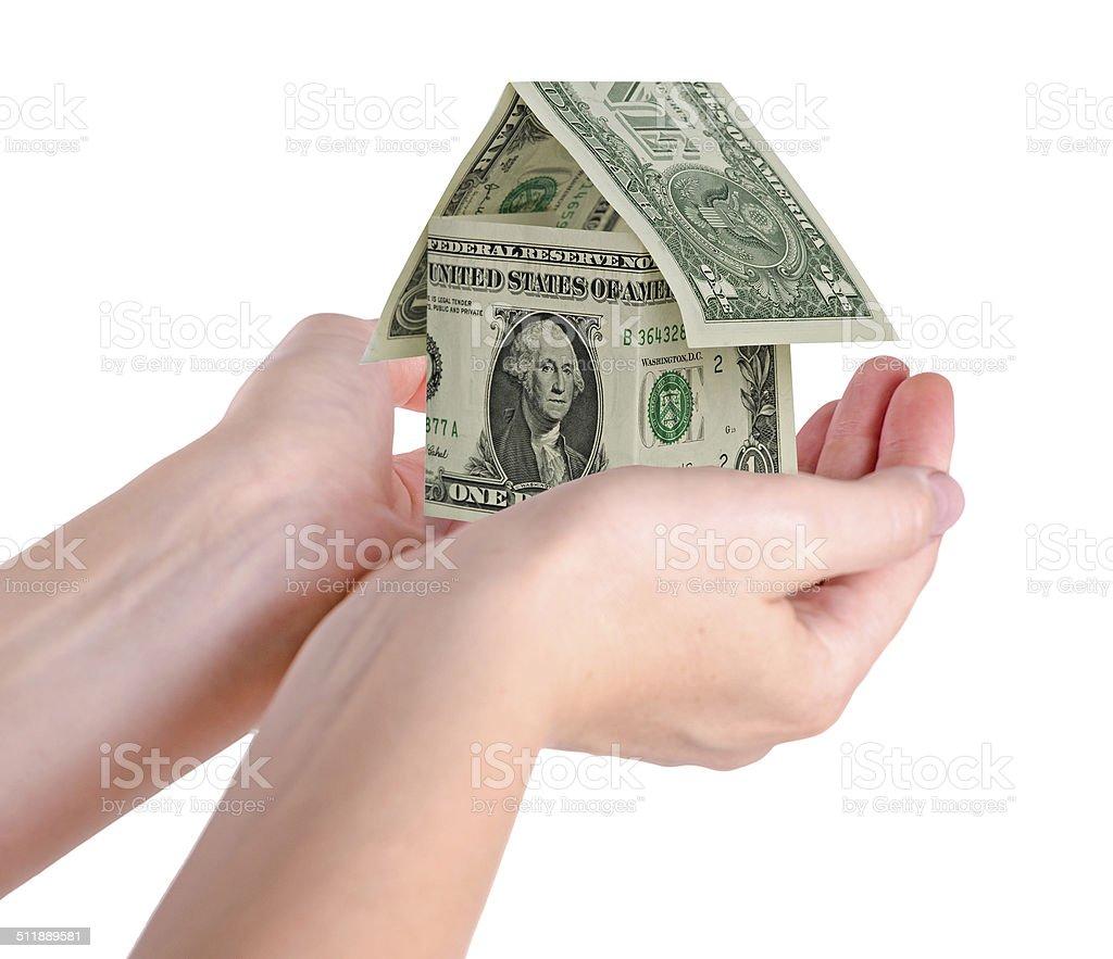 Money house in hands stock photo