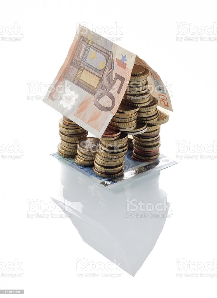 moneyhouse made of European Union coins and banknote stock photo