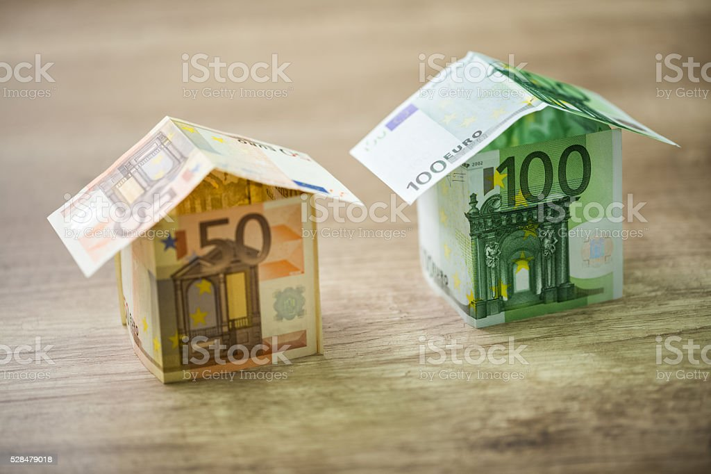Money houses built of euro banknotes stock photo