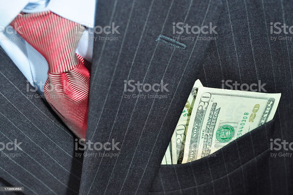Money in a business suit pocket. royalty-free stock photo