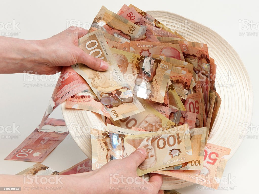 money in a hat stock photo