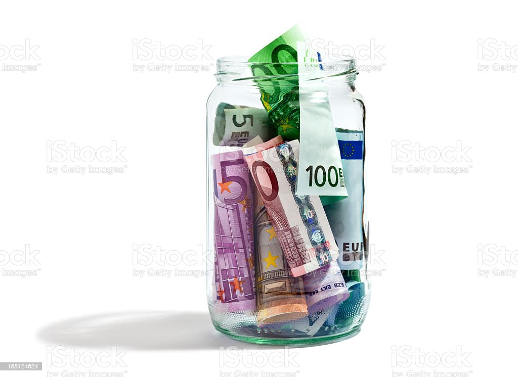 Money in a jar full of paper bill royalty-free stock photo