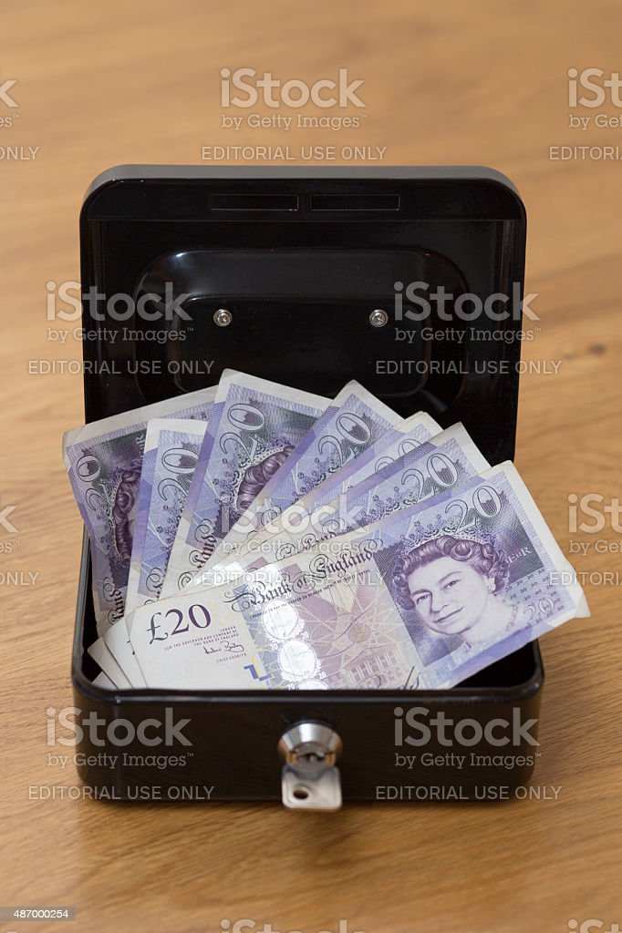 Money in a security box stock photo