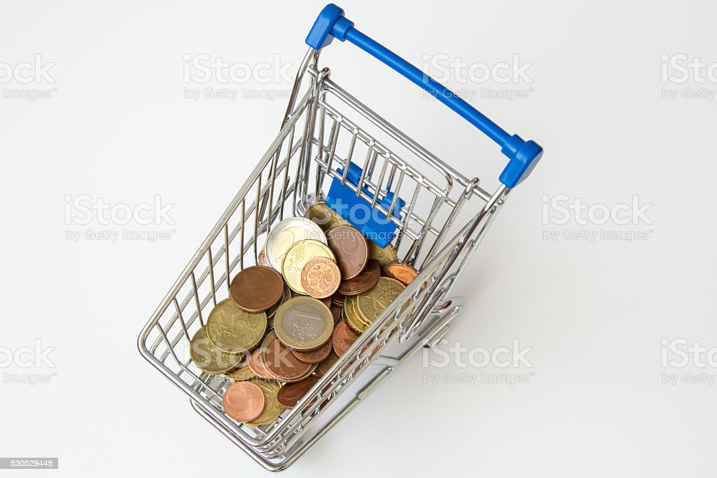 Money in a shopping cart stock photo