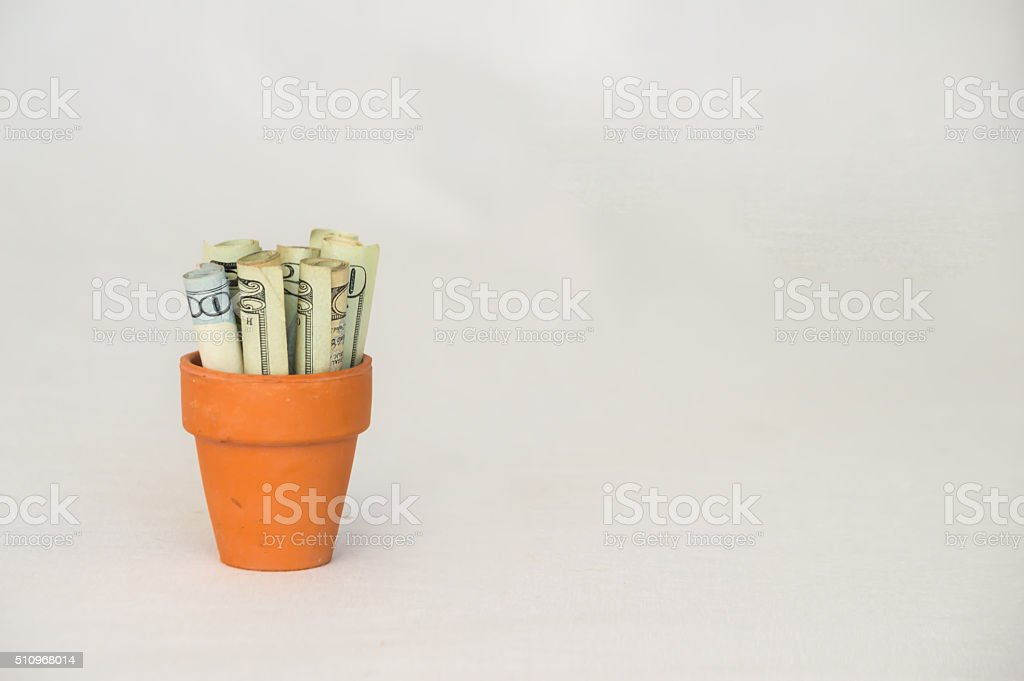 Money in a Terracotta Pot stock photo