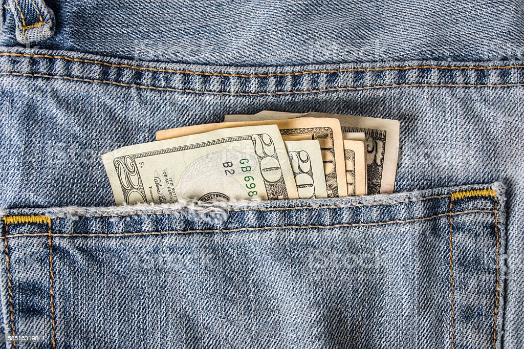 Money in back pocket stock photo