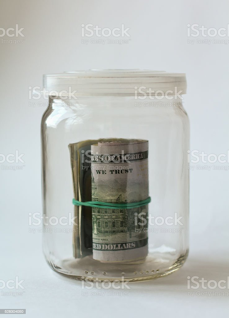 Money in glass jar on white background stock photo