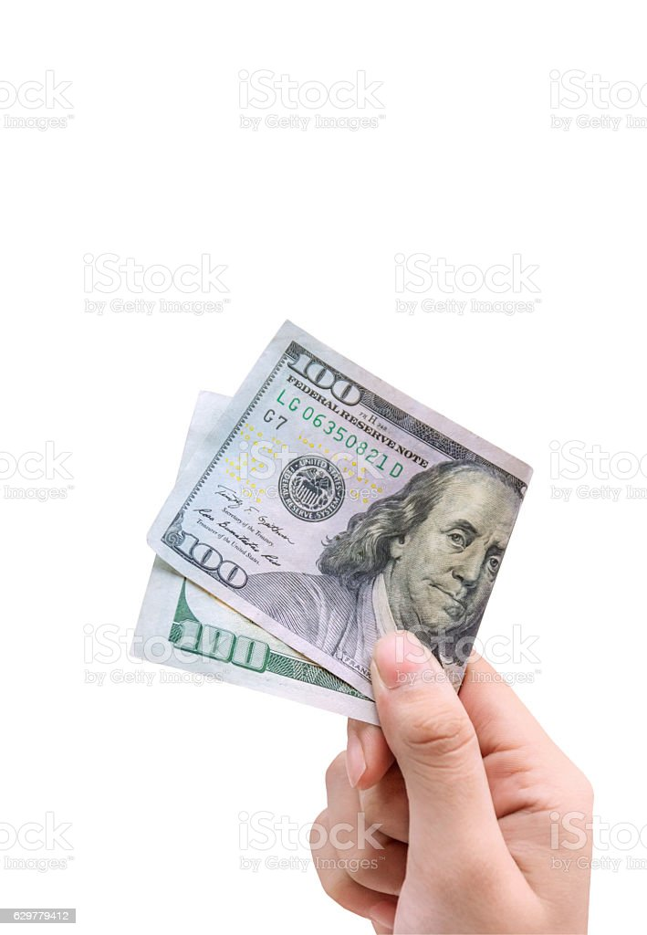 Money in hand, isolated on white background with clipping path. stock photo
