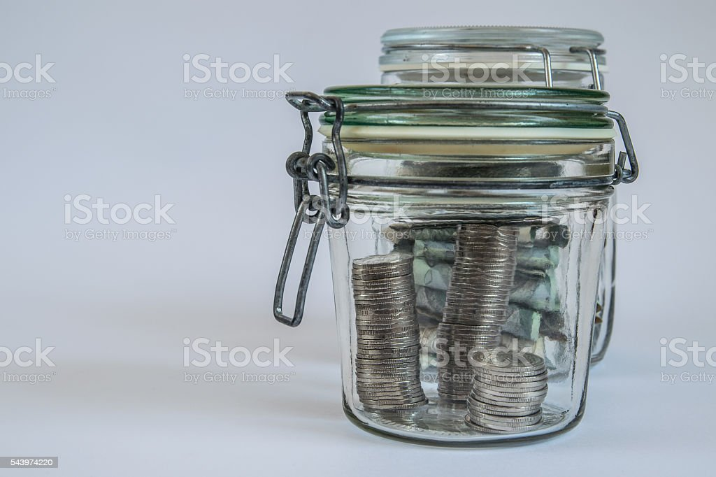 money in jars 1 stock photo