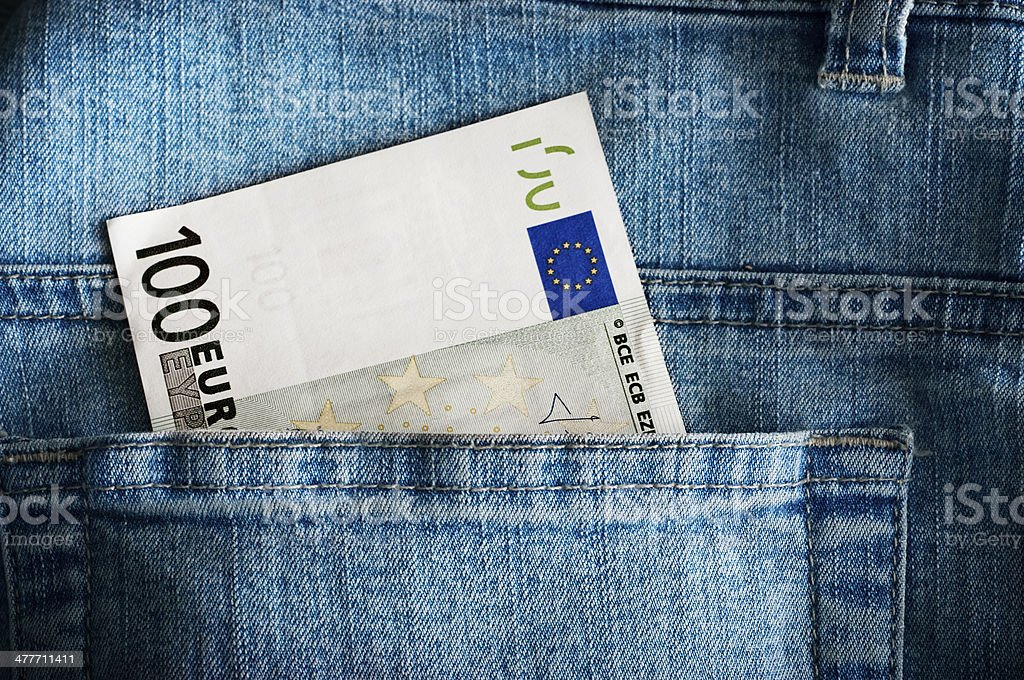 Money in jeans pocket stock photo