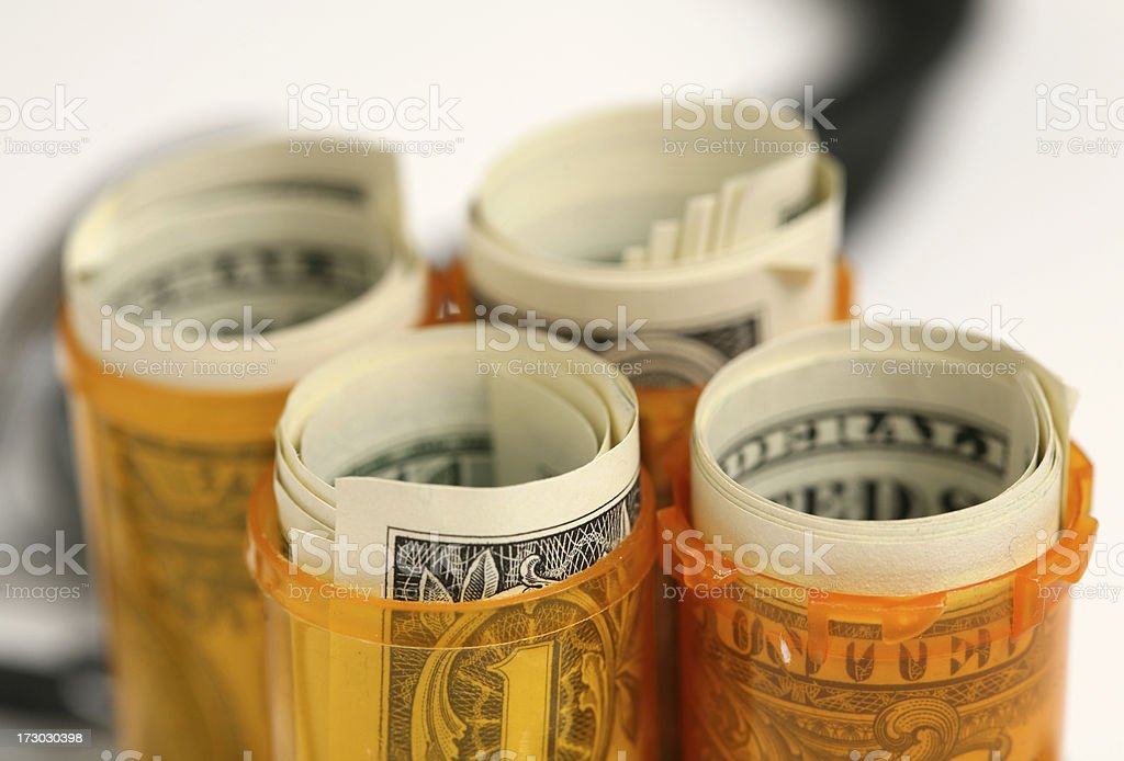 money in pill bottles royalty-free stock photo