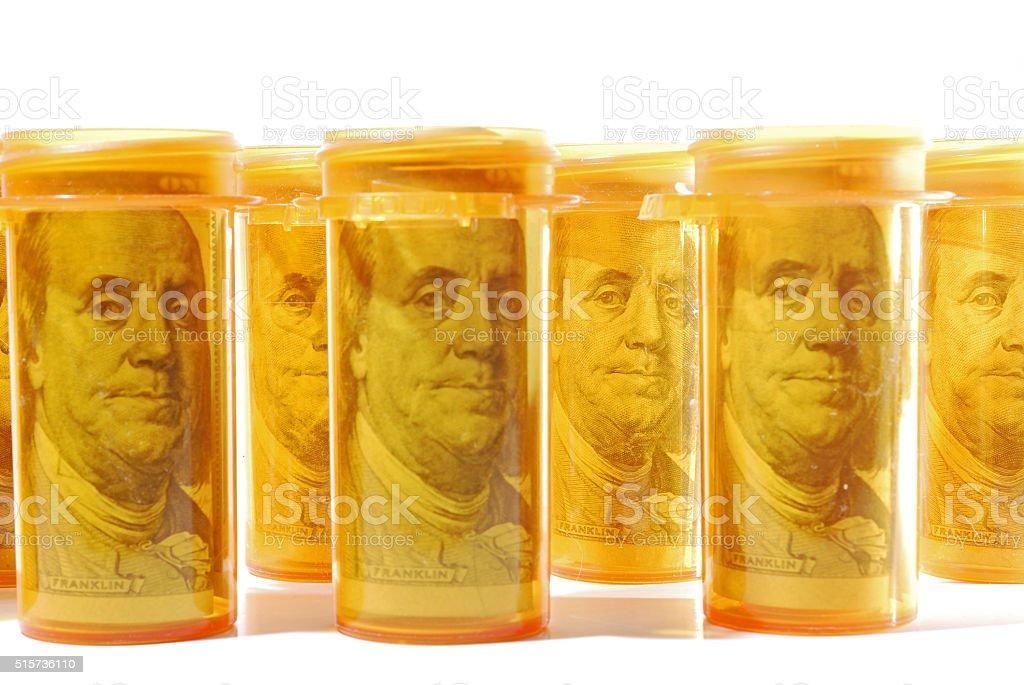 Money in Prescription Bottles stock photo