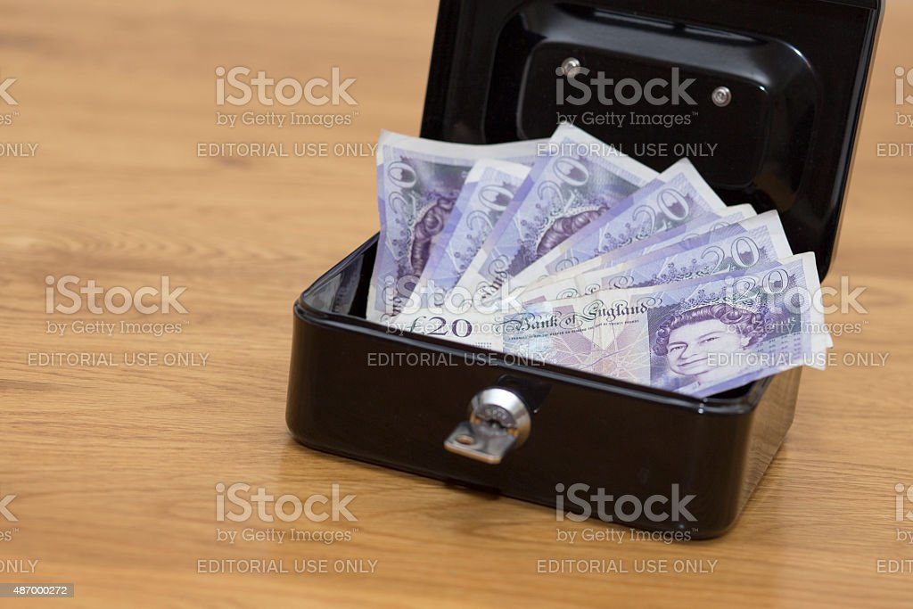 Money in security box on wooden tabel stock photo