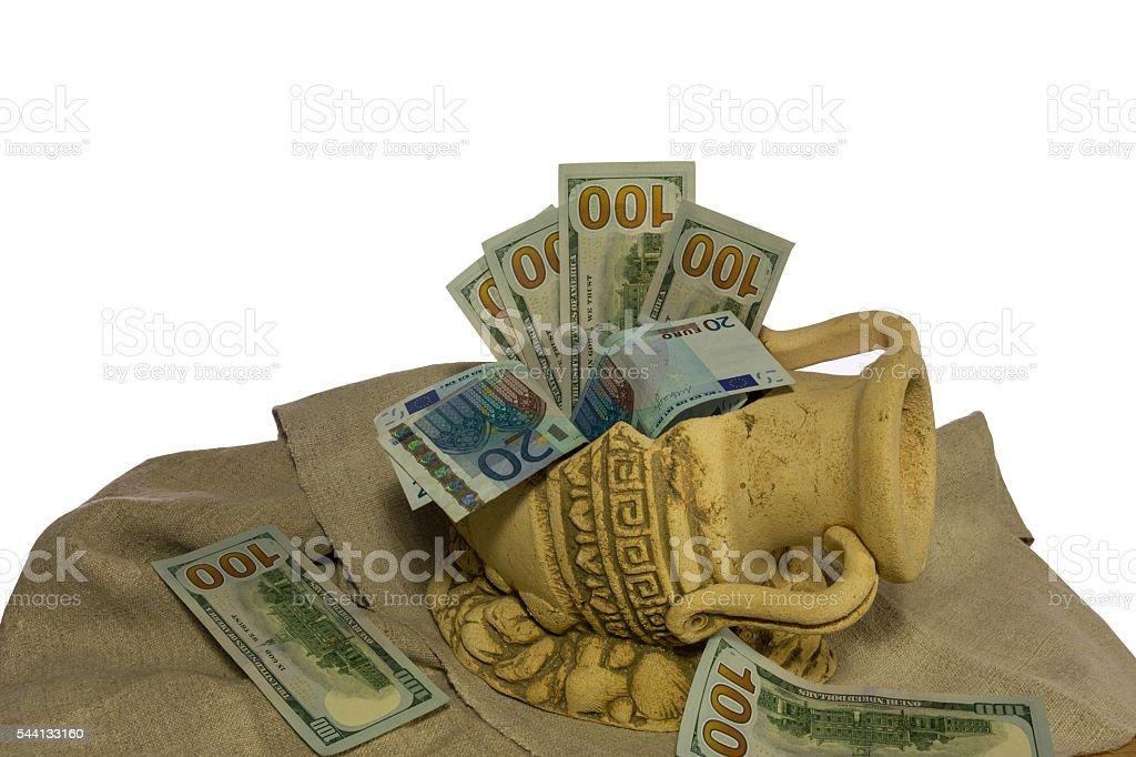 money in the broken jug stock photo