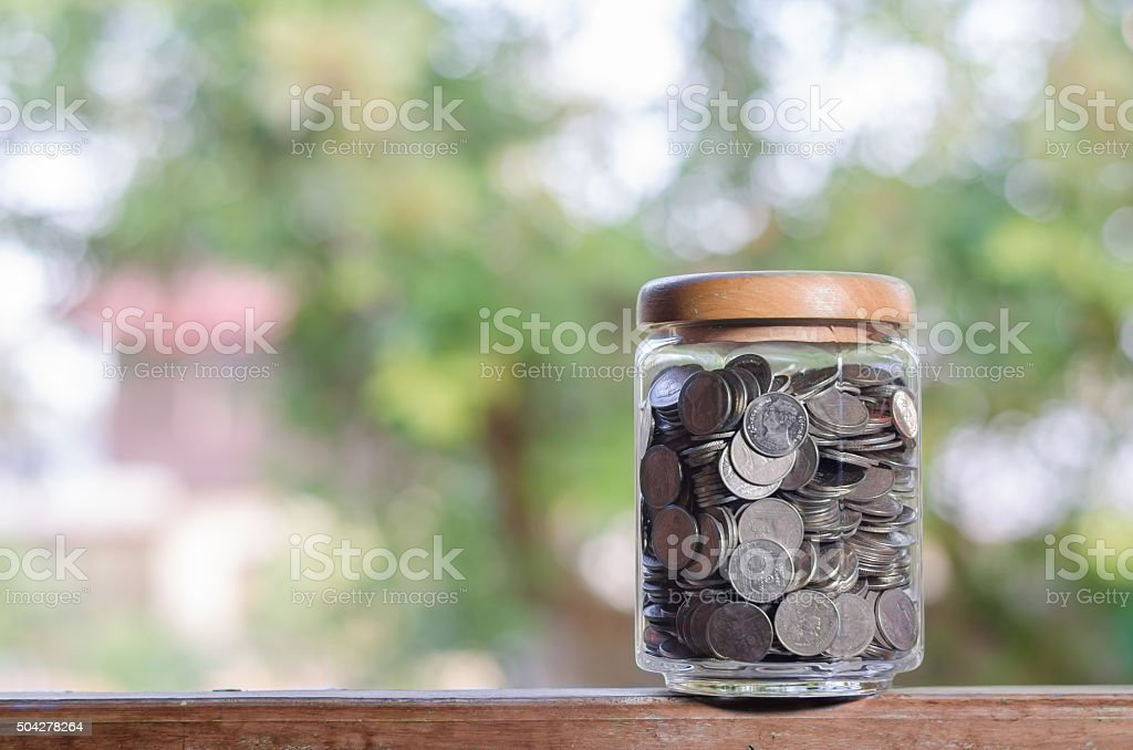 money in the glass bokeh stock photo