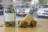 money in the glass bottle with Car showroom background blur