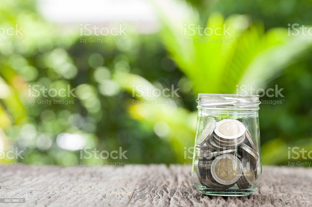 money in the glass stock photo